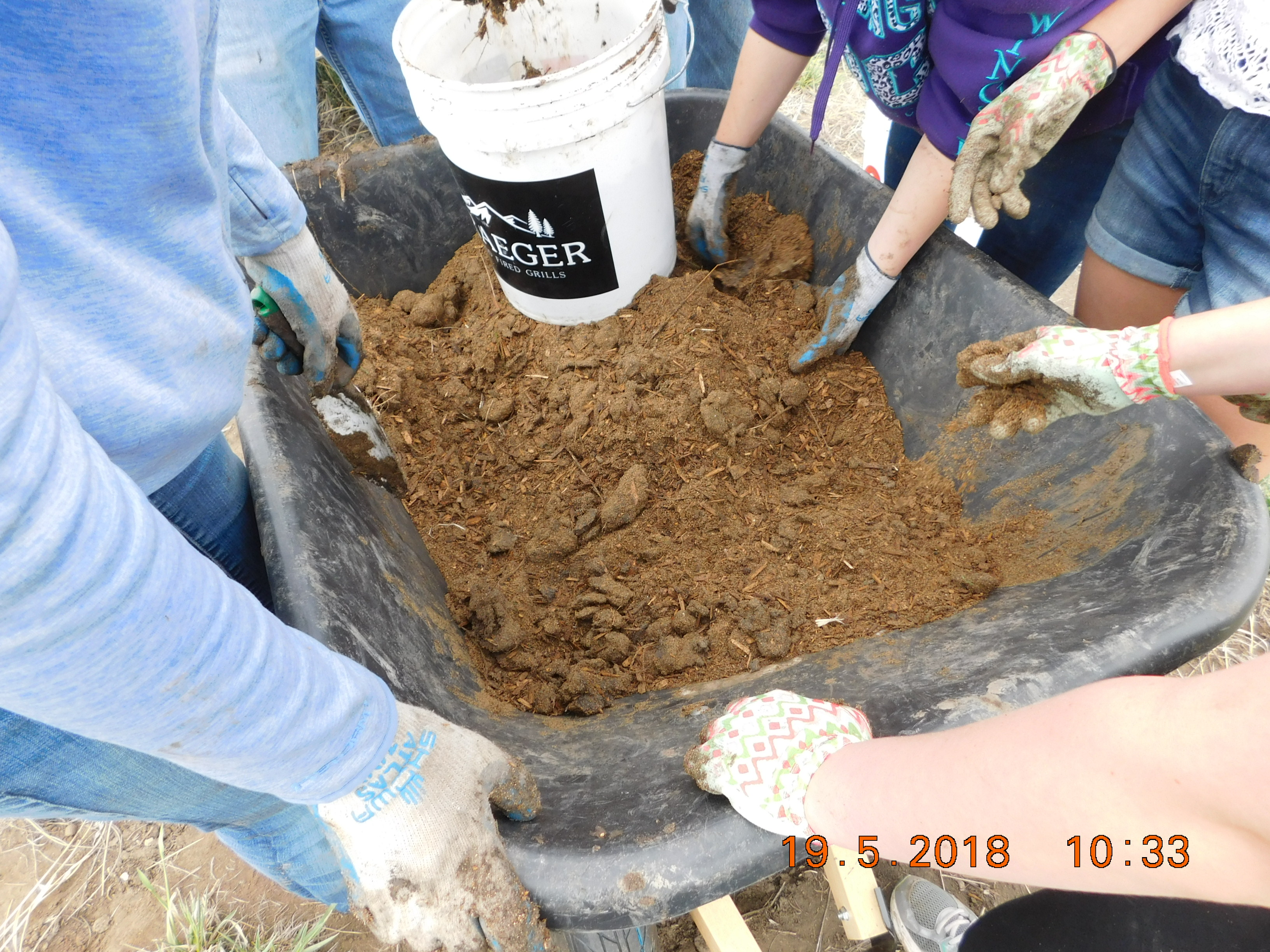 mixing soil for planting - a difficult job when mixing with the clay coming out of the ground