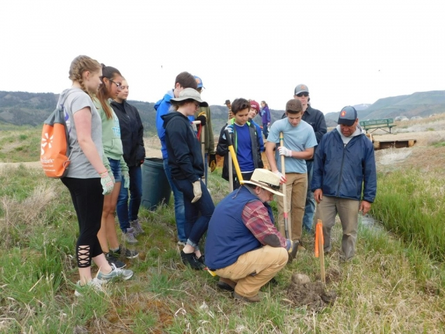 Interact volunteers getting instruction from UCRWG Scientist on Willow Planting