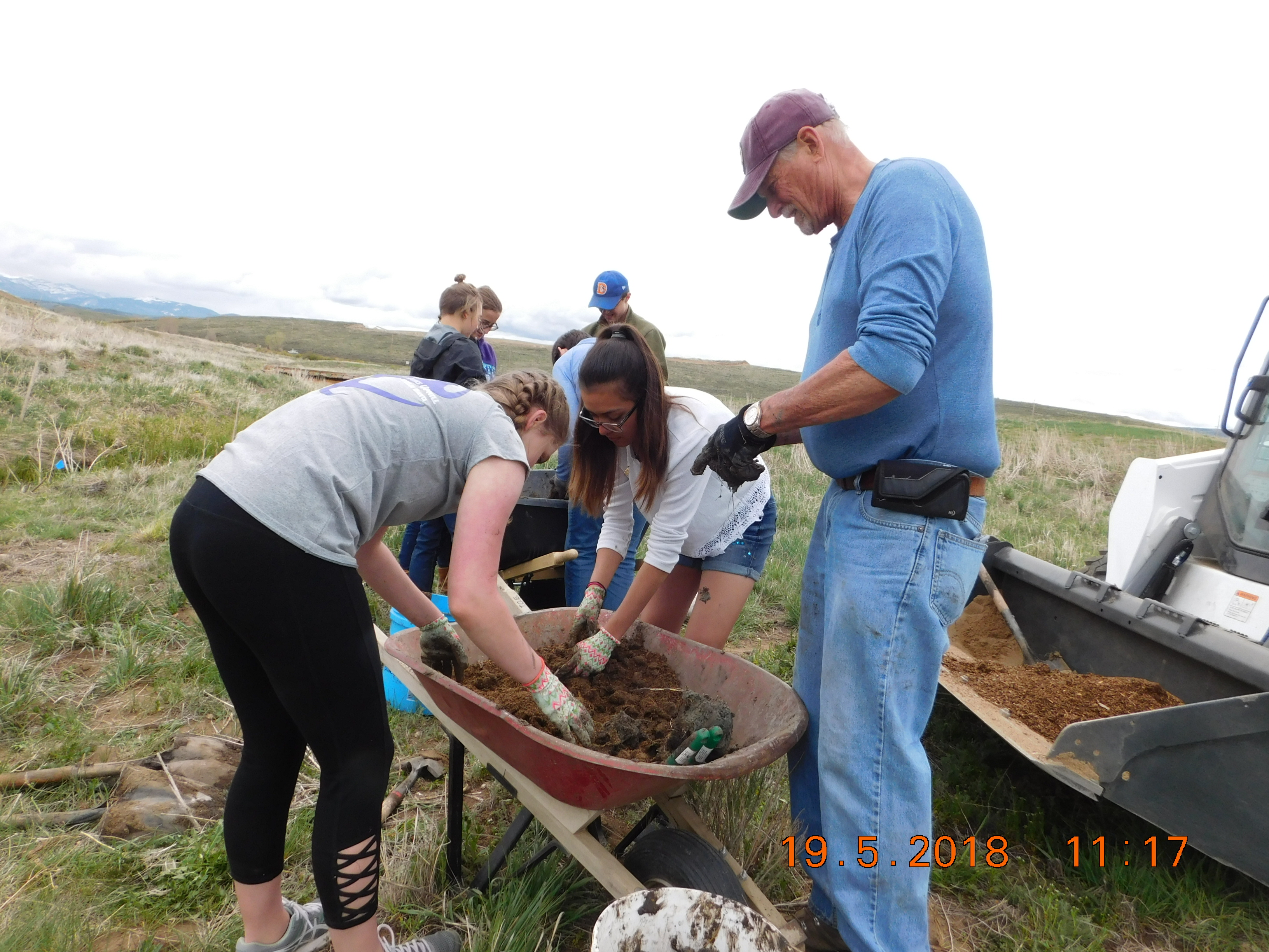 mixing soil for planting - a difficult job when mixing with the clay coming out of the ground upper colorado river watershed group